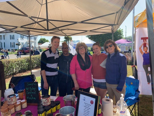 Heather, Loie, Brandi and a client at a farmers market selling hot fudge