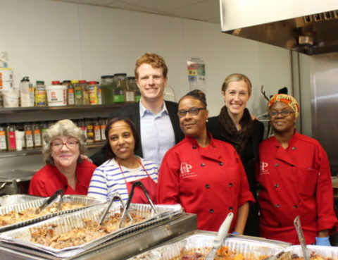 Representative Joseph Kennedy and wife Lauren posing with women of Project Place