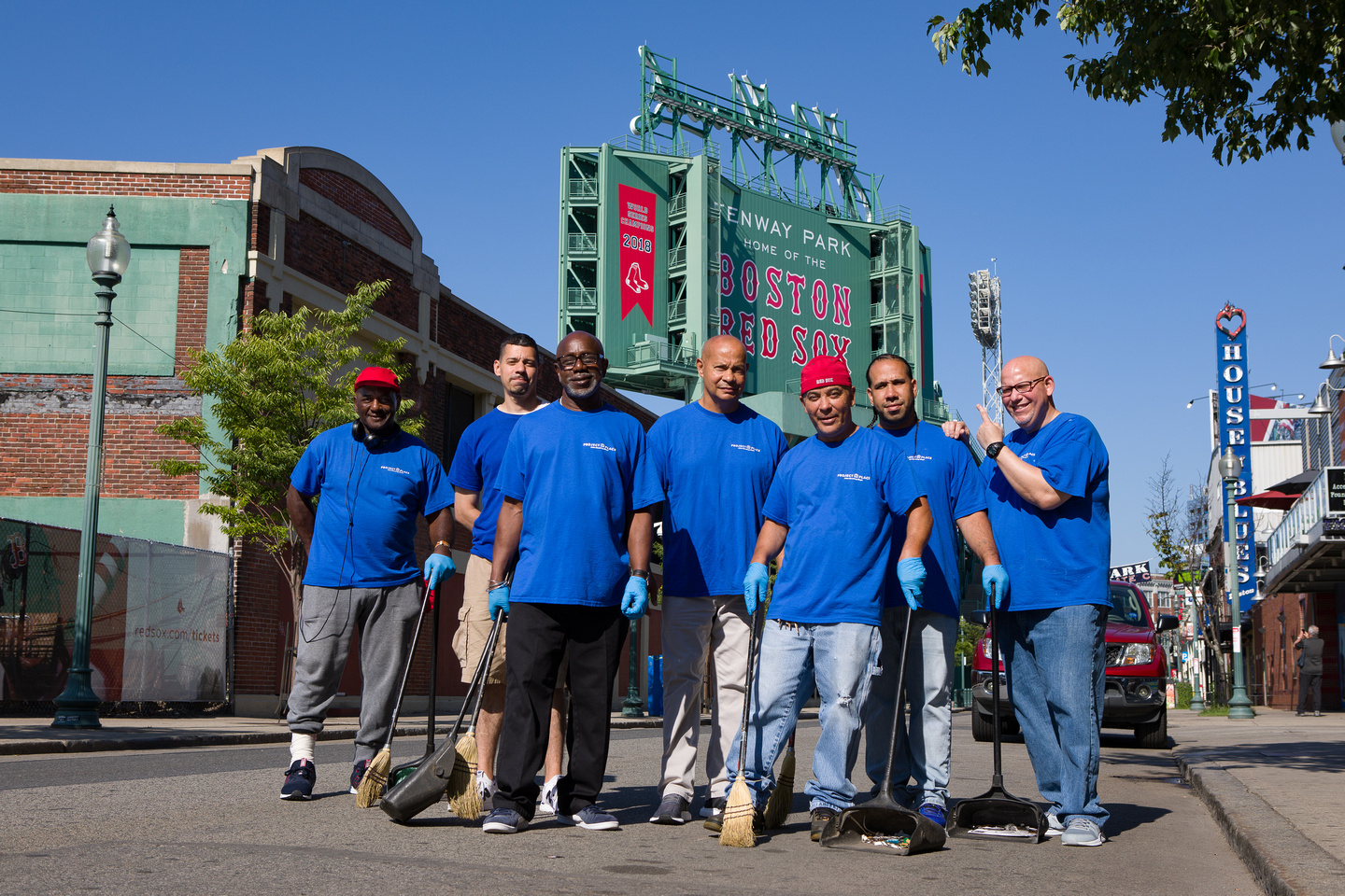 the clean corners bright hopes team standing in front of the fenway park sign