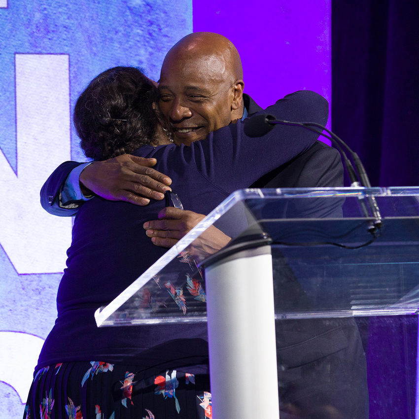 Polly Hanson hugging Dexter after he finishes giving his speech