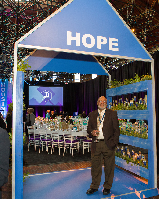Don standing under the Hope tent at our open door gala