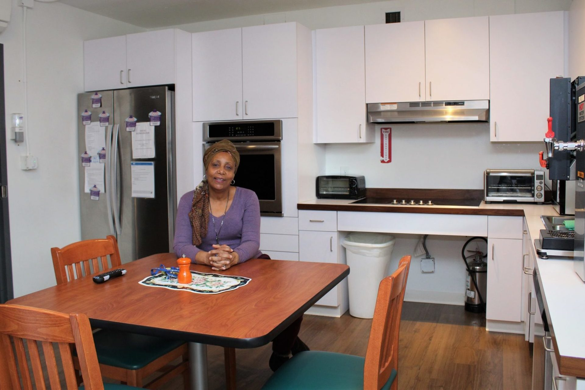 Yolette sitting in the kitchen of Betty's Place - our transitional housing program